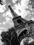 Bottom view of Eiffel Tower on sunny summer day, Paris, France. Stock Images