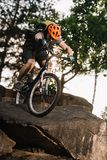 bottom view of extreme trial biker riding stock photo
