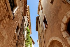 Bottom view of facades of ancient stone buildings at old european town, Antibes, France royalty free stock photo