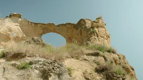 Bottom view of gigantic hole in Circle mountain. Bottom view of gigantic hole in cliff stock footage