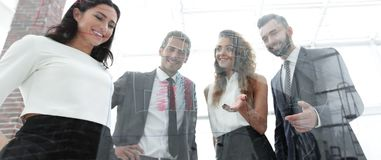 Bottom view.group of business people. Group of business people on the background of the office.photo with copy space Stock Photography