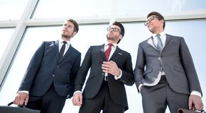Bottom view.a group of confident business peopl. From the bottom view.a group of confident business people .photo with copy space royalty free stock images