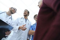 Group of doctors advising the patient. Bottom view.a group of doctors advising the patient Stock Image