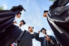 bottom view of happy young graduated students in front of royalty free stock images