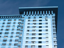 Bottom view of high modern apartment building. On deep blue sky Royalty Free Stock Photography