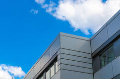 Bottom view-House facade. Cloud game, a house facade in front of a blue Hhimmel with white clouds Stock Images