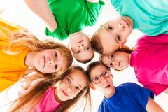 Kids faces in a round. The bottom view of kids faces round. Friendship in the camp, team concept royalty free stock image