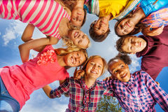 Bottom view of kids group standing in round shape Stock Photography