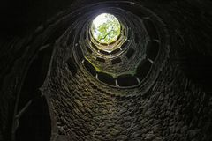 bottom view of light and trees in the end of spiral stairs, portugal, quinta stock photography