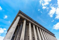 Bottom view of Magdalenae church corner in Roman style. Paris, France Royalty Free Stock Photography
