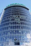 A bottom view of the mirrored building of processing center of Sberbank head office on the background of cloudy sky in Novosibirsk royalty free stock photography