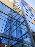 Bottom view on modern building with glass Windows royalty free stock image