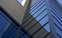 Bottom view on modern building with glass Windows.  stock photography