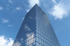 Bottom view of modern business skyscraper. In business district in day sunlight under blue sky with clouds raising to sky, business offices corporate building Stock Photos