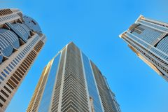 Bottom view of modern skyscraper. Business district Royalty Free Stock Photos
