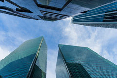 Bottom view of modern skyscrapers in business district against s Royalty Free Stock Photo