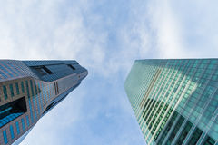 Bottom view of modern skyscrapers in business district against s Royalty Free Stock Image