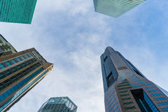 Bottom view of modern skyscrapers in business district against s Stock Image