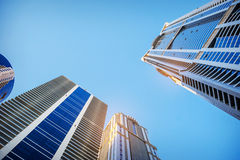 Bottom view of modern skyscrapers in business district in evenin Stock Photography