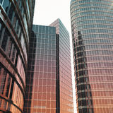 Bottom view of modern skyscrapers in business district in evening light at sunset. Industrial architecture, business. Construction and estate financial concept Stock Photo