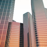 Bottom view of modern skyscrapers in business district in evening light at sunset. Industrial architecture, business. Construction and estate financial concept Stock Images