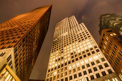 Bottom view of modern Skyscrapers at night. Ministry of Foreign Affairs in Hague, Netherlands royalty free stock images