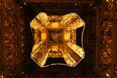 Bottom view of night lighted Eiffel tower Royalty Free Stock Photography