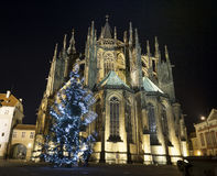 Bottom View Night St Vitus Cathedral. With Blurred Christmas Tree on Wind. View from Below. Prague - Czech Republic - Europe royalty free stock images