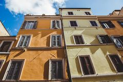 Bottom view of old buildings on street of Rome on sunny. Day, Italy royalty free stock photo