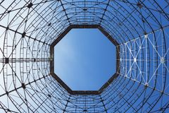 Bottom view of old cooling tower. In front of blue sky royalty free stock image