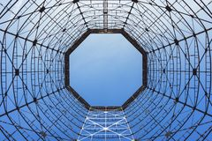 Bottom view of old cooling tower. In front of blue sky stock images