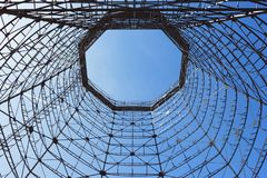 Bottom view of old cooling tower. In front of blue sky stock photos
