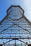 Bottom view of old cooling tower. In front of blue sky royalty free stock photography