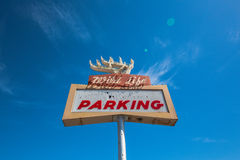 Bottom view of parking road sign and blue sky. Royalty Free Stock Images