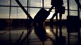 Bottom view of passenger legs walking at airport terminal, travel, vacation stock video