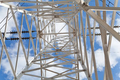 Bottom view power transmission lines against blue sky Stock Photo