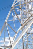 Bottom view power transmission lines against blue sky Royalty Free Stock Photography