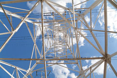 Bottom view power transmission lines against blue sky Stock Image