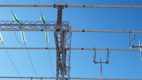 Electrical distribution substation with ceramic insulators. Bottom view powerful electrical distribution substation with green ceramic isolators against sky and stock video footage