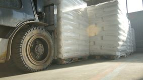 Bottom View Powerful Forklift Puts Large Bag Pile on Floor stock video footage