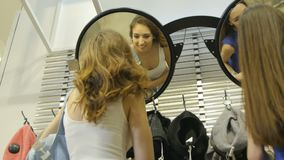 Bottom View Pretty Women Turn around at Mirror with Bags stock video