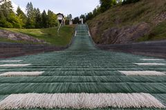 Ski jumping slope and tracks on summer Royalty Free Stock Images