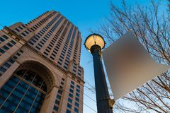 Bottom view of skyscraper and lamppost with sign, Atlanta, USA Royalty Free Stock Images