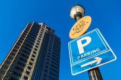 Bottom view of skyscraper and lamppost with signs, Atlanta, USA Royalty Free Stock Images
