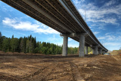 Bottom view on steel highway bridge spans on concrete supports. Stock Photos