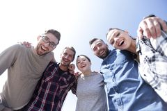 Bottom view.successful creative business team looking at camer. A.the concept of teamwork Stock Photo
