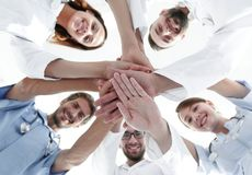 Bottom view.a team of doctors at the medical center clasped their hands together. The concept of unity stock photos