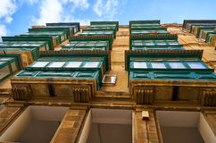 A bottom view to the traditional Maltese style balconies. Vallet. A view from the bottom up to the traditional Maltese style colored balconies. Valletta. Malta Stock Photos