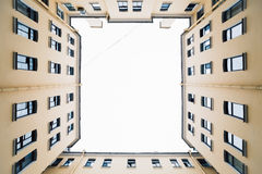 Bottom view to vintage old buildings. Old courtyard. Bottom view to vintage old buildings stock image