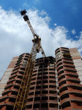 Bottom view on tower crane on building construction at works Stock Photography
